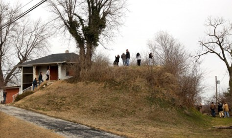 A group of people from the Osage Nation tour a Native American mound in St. Louis on Tuesday, March 19, 2013. The tribe purchased Sugarloaf Mound and the house built on top of it, located at 4420 Ohio Street in St. Louis, in 2009. Photo By David Carson, dcarson@post-dispatch.com