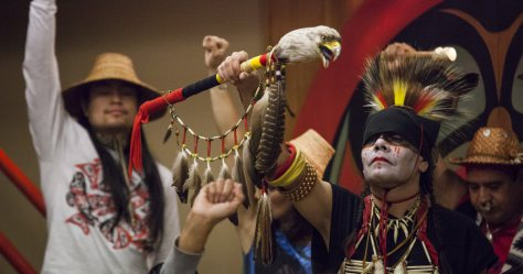 """SEATTLE, WA - OCTOBER 13: Nikk """"Red Weezil"""" Dakota (R), from the Turtle Mountain Band of Chippewa, celebrates with others from various tribes during Indigenous Peoples' Day events at the Daybreak Star Cultural Center on October 13, 2014 in Seattle, Washington. Earlier that afternoon, Seattle Mayor Ed Murray signed a resolution designating the second Monday in October to be Indigenous Peoples' Day. (Photo by David Ryder/Getty Images)"""