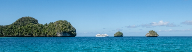 Our ship at Wayag, Raja Ampat, Indonesia, nestled between forested karst islets that are the poster image for the region